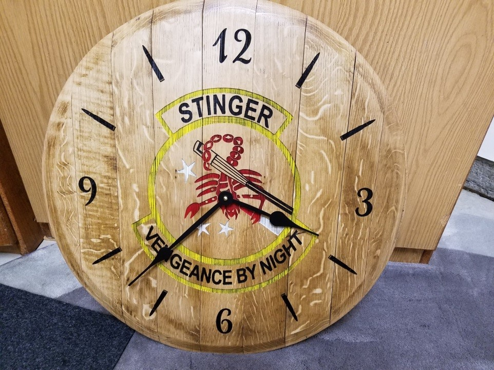 Stinger wall clock made of wood